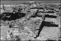 Roomblock and Kiva 1, Area 1, facing west. Note loss of southern and northern walls to erosion. (BW-YJ-JC-007)