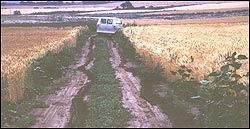 Problems on a muddy road for the field van, close to 5MT3, 1981.
